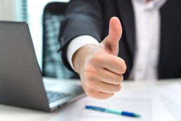 Business man showing thumbs up in office. © terovesalainen / Fotolia